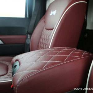 Custom dark red leather with white contrast stitching, diamond stitch inserts, piping, and the Jeep logo.